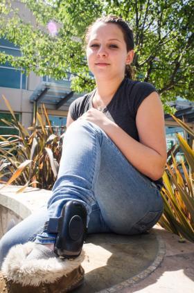 17-year-old Elisa Morris-Jackson showing her GPS ankle monitor.