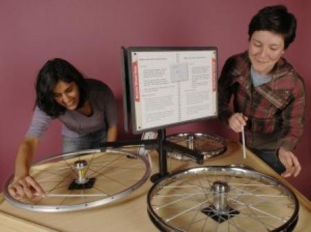 "The Bicycle Wheel Harp at the ""Sound – Hearing"" exhibit at the SF Exploratorium. Photo courtesy of the Exploratorium"