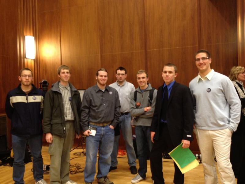 A group of Republican Ron Paul supporters gather before the caucuses. Paul dominated this student-centric caucus.