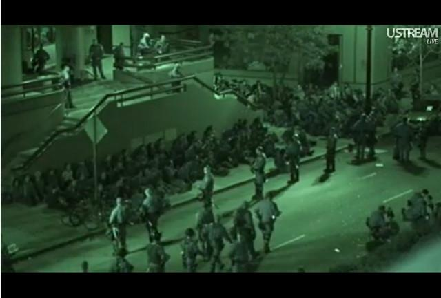 Police round up Occupy Oakland protesters outside a downtown YMCA.:
