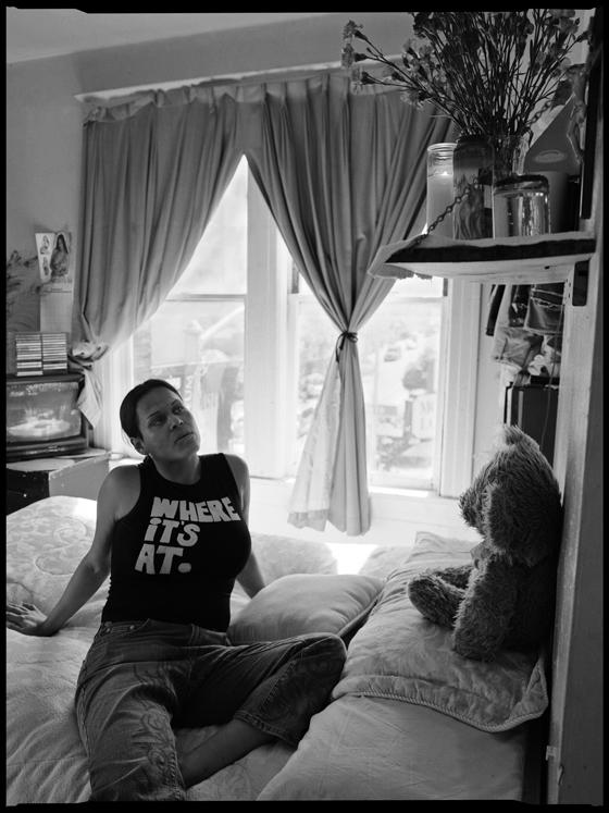 Vanessa, a transgender sex worker with her altar to Santa Muerte, in her SRO in San Francisco's Tenderloin. It's among many photos in Rick Nahmias' Golden States of Grace: Prayers of the Disinherited, now in Santa Clara University's deSaisset Museum.