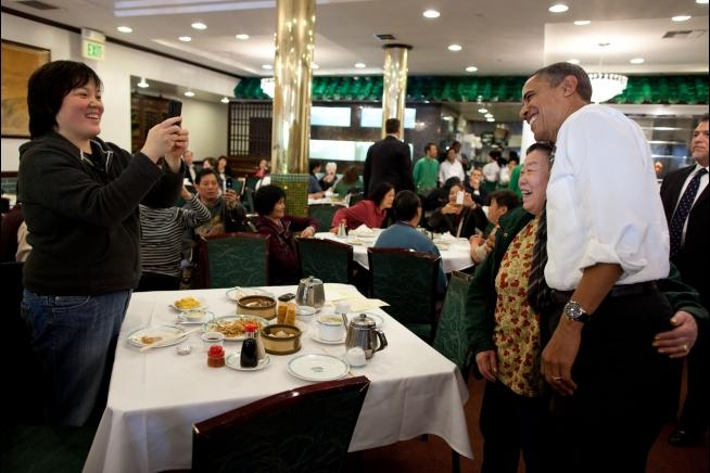 President Barack Obama poses for a picture during a stop at Great Eastern restaurant in San Francisco's Chinatown