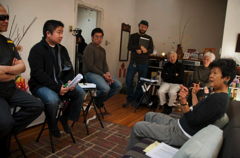 "Artistic director Rene Yung (right) gives instructions to the proxy storytellers during a rehearsal of the theater and oral history project ""Chinese Whispers."" Photo courtesy of Chinese Whispers"