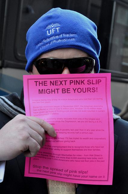 Occupy protesters in New York make a statement about unemployment with their pink slips