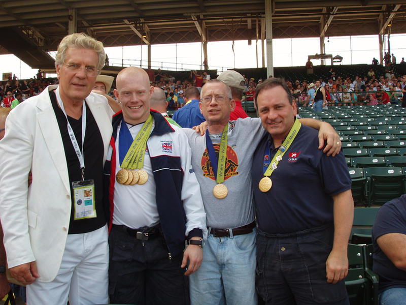 David Kopay (left) at closing ceremonies of Gay Games VII, Chicago, 2006, with world champion powerlifter Chris Morgan, B.A.R. sports columnist Roger Brigham, and Golden Gate Wrestling Club President Gene Dermody.
