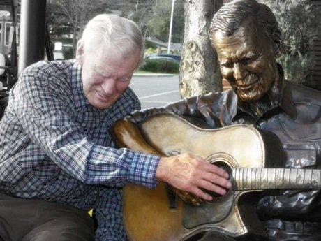 Doc Watson meets his statue in his home town of Boone, NC.