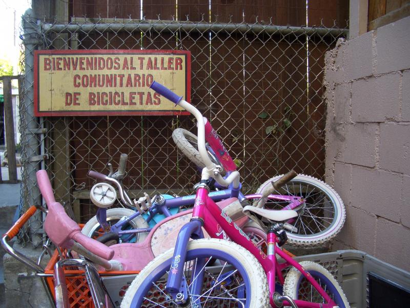 Kid-size bikes and another volunteer-painted sign