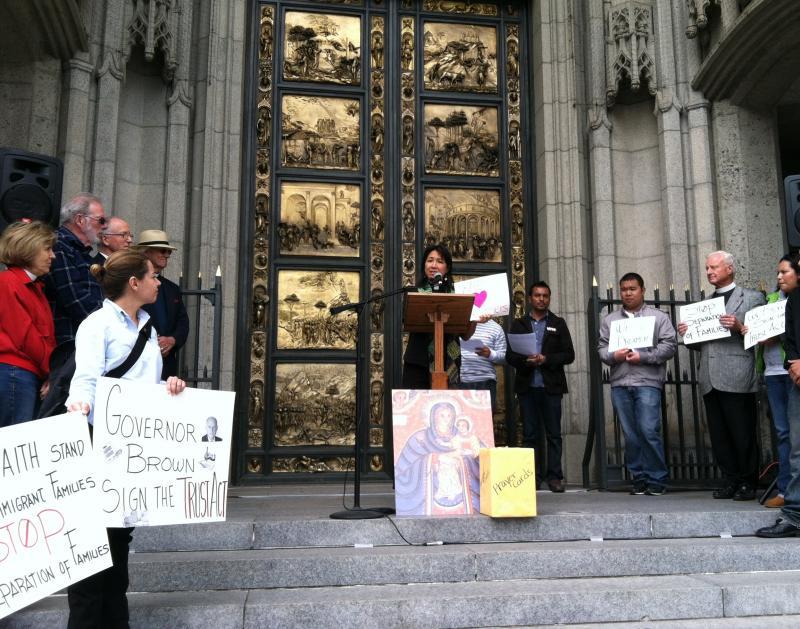 Rev. Debbie Lee addresses Dreamers on the steps of the Grace Cathedral