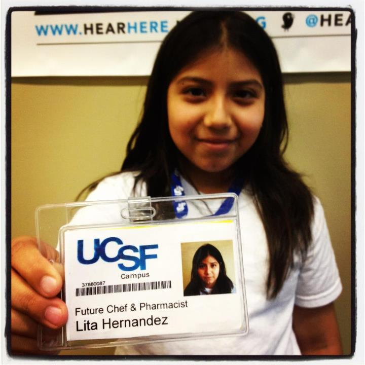East Oakland fifth grader Lita Hernandez shows off the ID badge given to her by her new mentors at the UCSF School of Pharmacy.