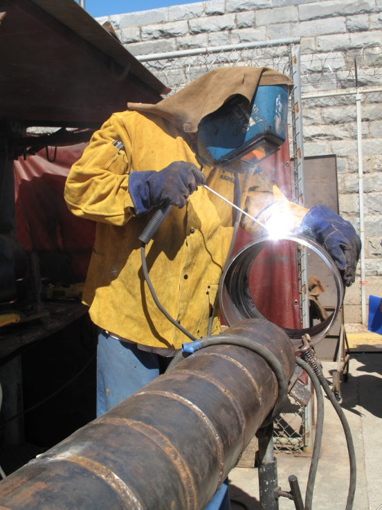 Inmate Johnny Ames demonstrates his welding skills.