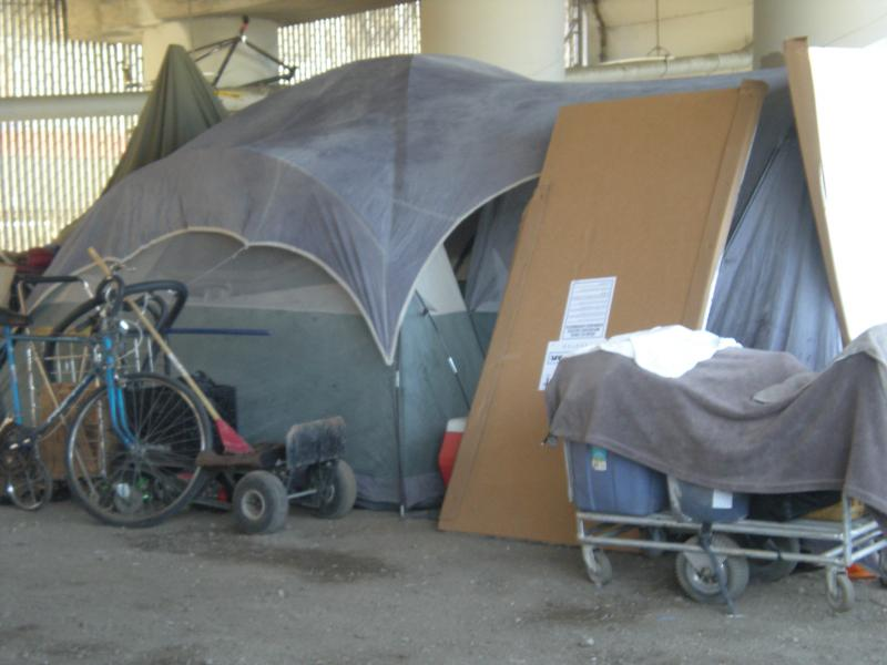One of several tents under the I-280 on-ramp at 5th and King, in San Francisco.
