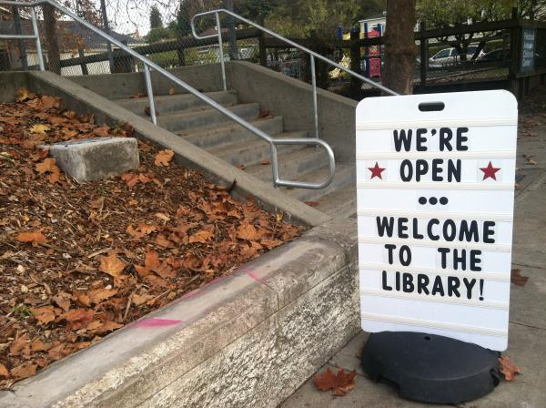 Signs welcome patrons at the new location of the Piedmont library