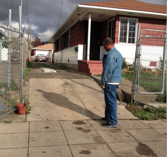 Adam Blueford stands over the spot where his son, Alan, died on May 6, 2012 in an officer-involved shooting in Oakland.