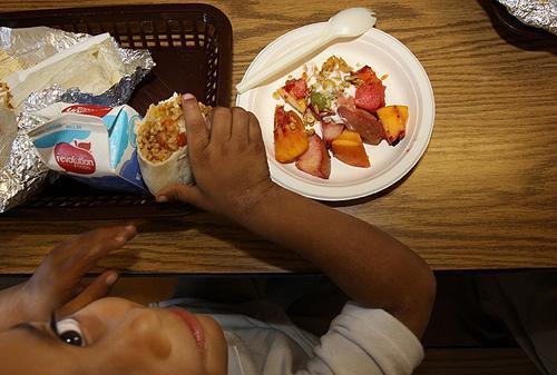 "Alex ""Junior"" Nava, age 5, eats a lunch prepared by Revolution Foods."