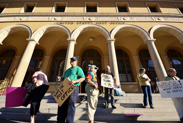 Demonstrators at a rally outside the Downtown Berkeley Post Office in July 2012.