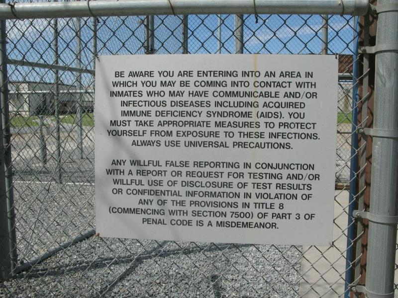 Warning sign on the gate as we enter the sally port.