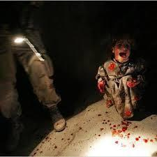 Tal Afar, Iraq, 18 January, 2005: Samar Hassan, 5, screams after her parents were killed by US soldiers