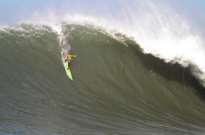 on Banner drops into a huge wave at the 2010 Mavericks Surf Contest.
