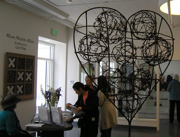 The East Gallery of the Peninsula Museum of Art, dedicated to sculpture, opens with works in bronze and recycled metals by Lori Kay, an early Artist in Residence with Recology