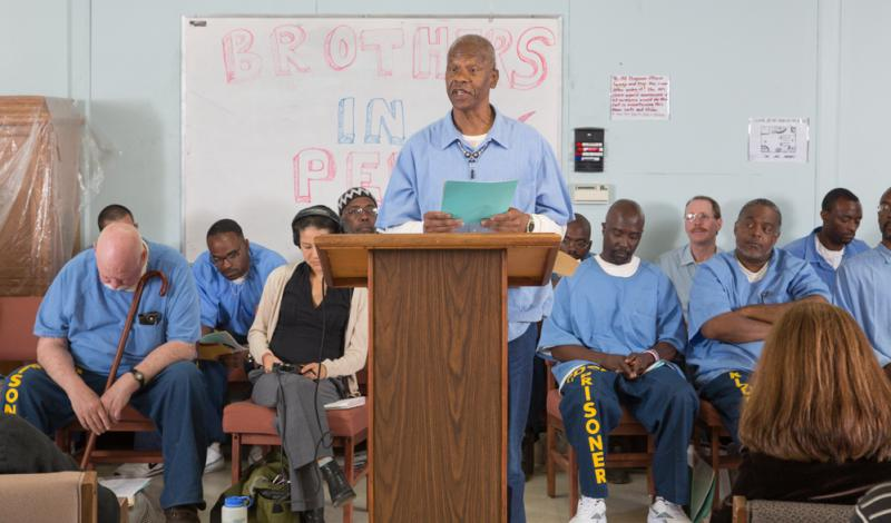 An inmate reads a story at San Quentin's creative writing class