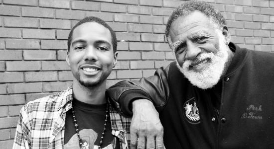 Author Myles Bess with community leader Arnold Perkins