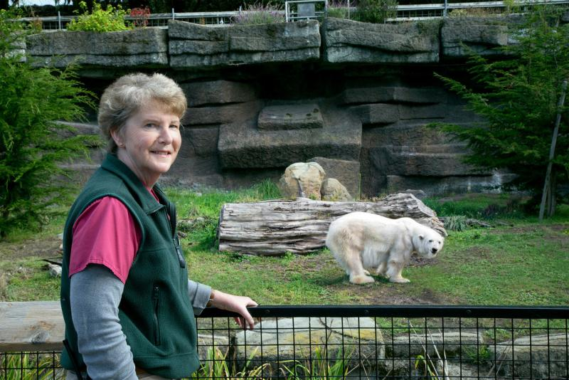 San Francisco Zoo vet tech Gail Hedberg poses with Pike, a 30-year-old polar bear she raised from birth.