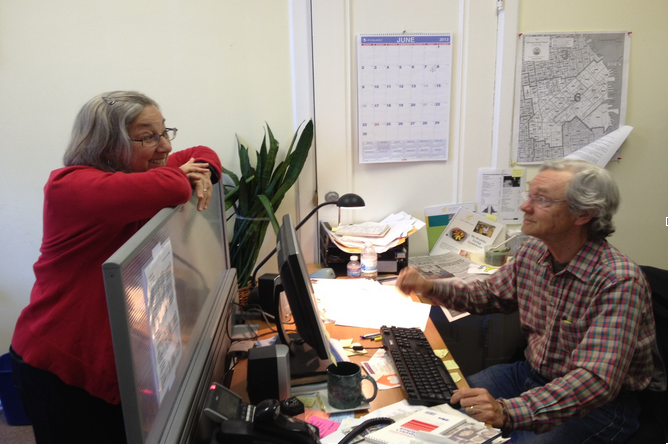 Marjorie Beggs and Tom Carter in their office