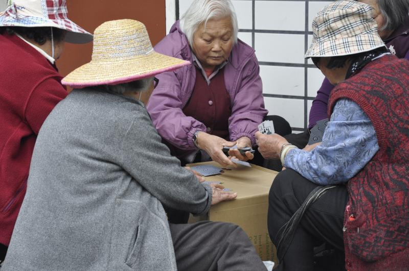 Chinese women play cards in Portsmouth Square