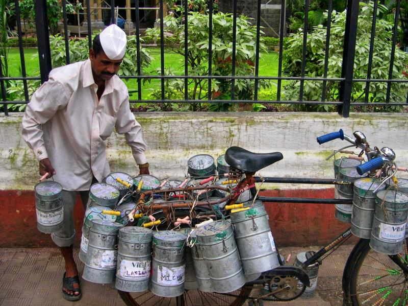 a Dabbawala delivers food.