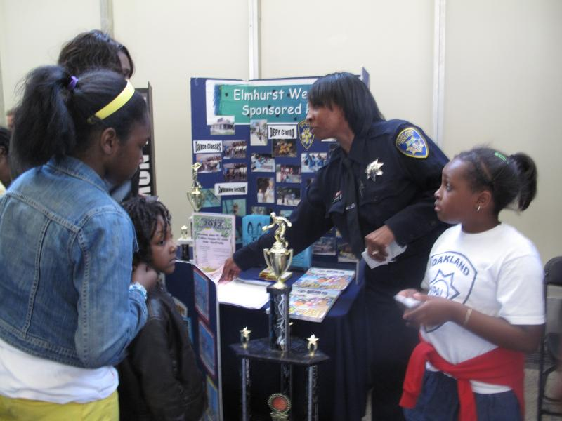 OPD officers engage with local community members during their annual open house