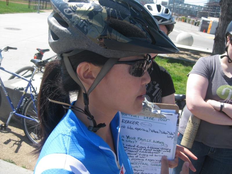 Tracy Zhu talking to cyclists on her toxic tour