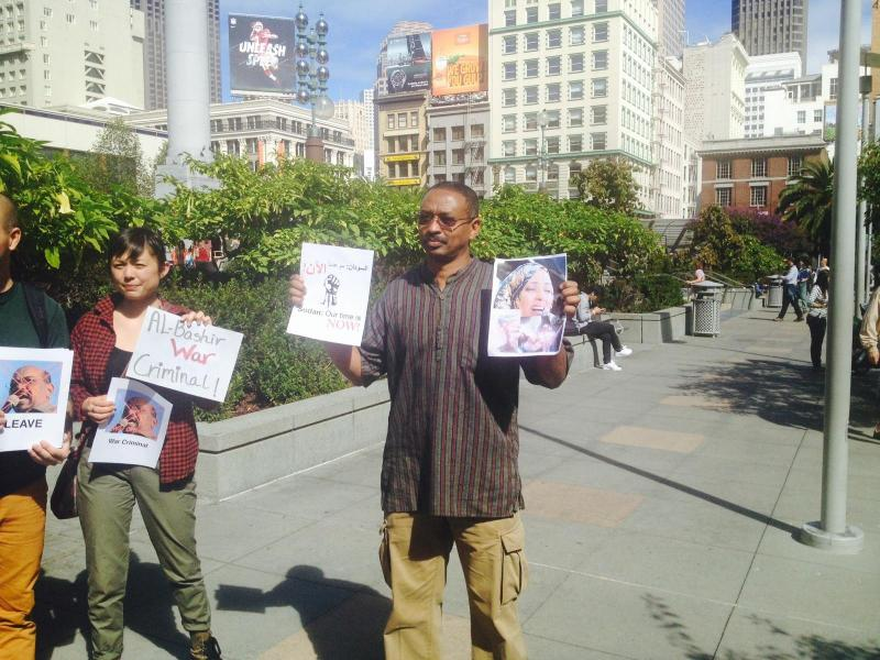 Holding pictures of the deceased- SF Protests