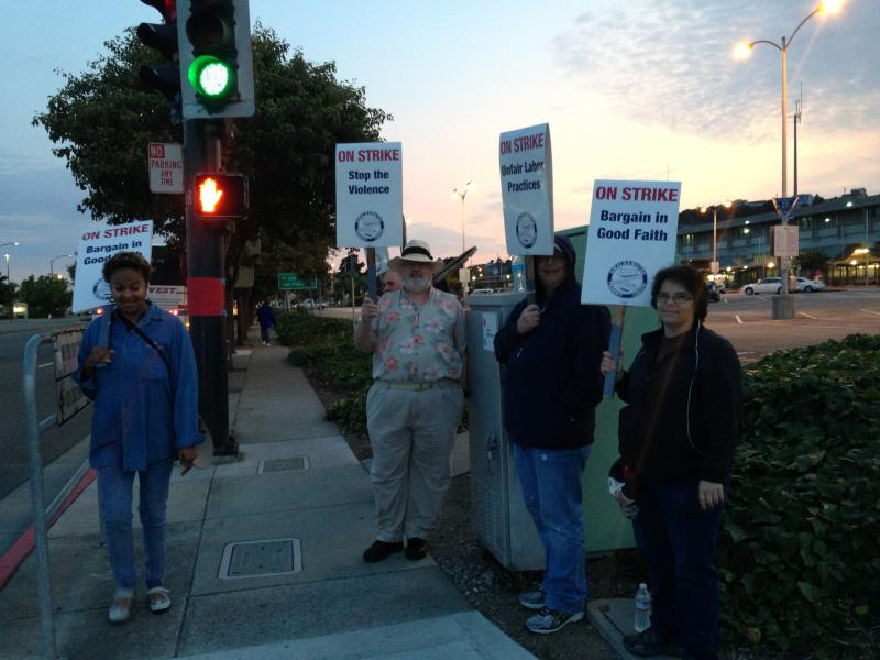 BART workers picket an East Bay station during the July strike.