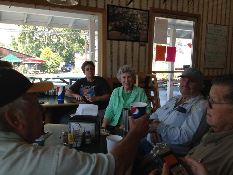 Wes Smoot (far right), Don Pardini (second from right) and friends socialize at the Redwood Drive-in in Boonville, CA.