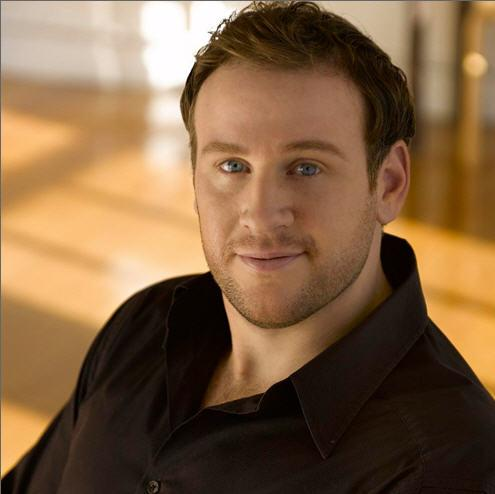 "Lucas Meachem sings Figaro in Rossini's ""Barber of Seville""."