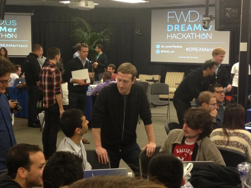 Mark Zuckerberg advises a team of DREAMer hackers at the FWD.us DREAMer Hackathon