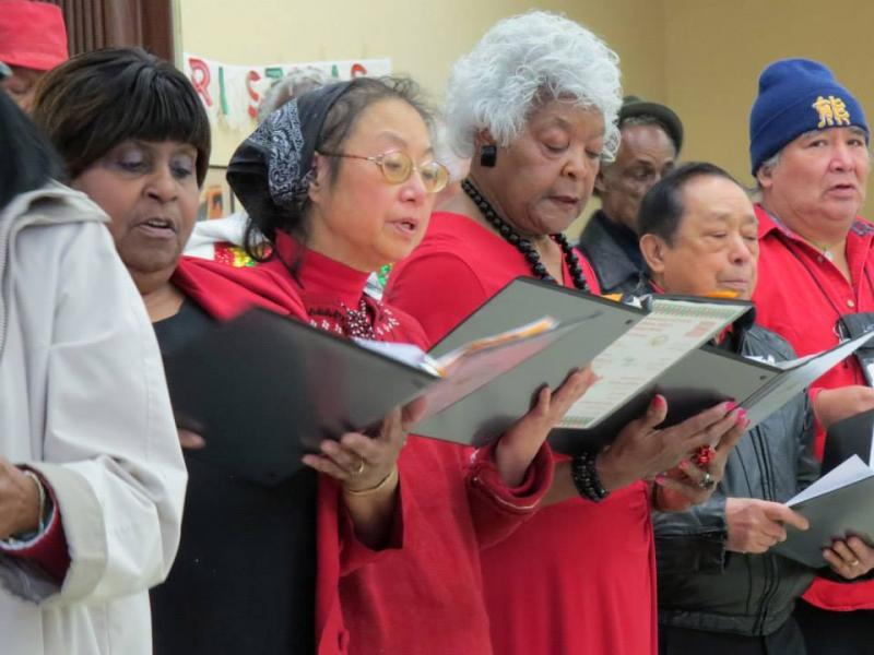 The Western Addition Senior Center choir performs at a Christmas concert