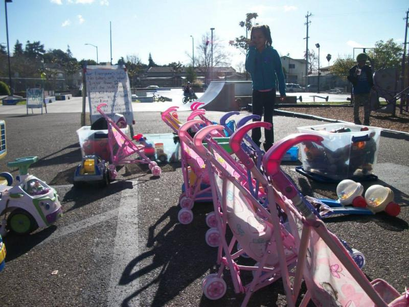 The first Saturday of the month, local families come together for a community playdate at Youth UpRising, a large teen center across from Castlemont High School. A young girl admires the wide selection of toys, all of which organizer Stephanie Pepitone ha