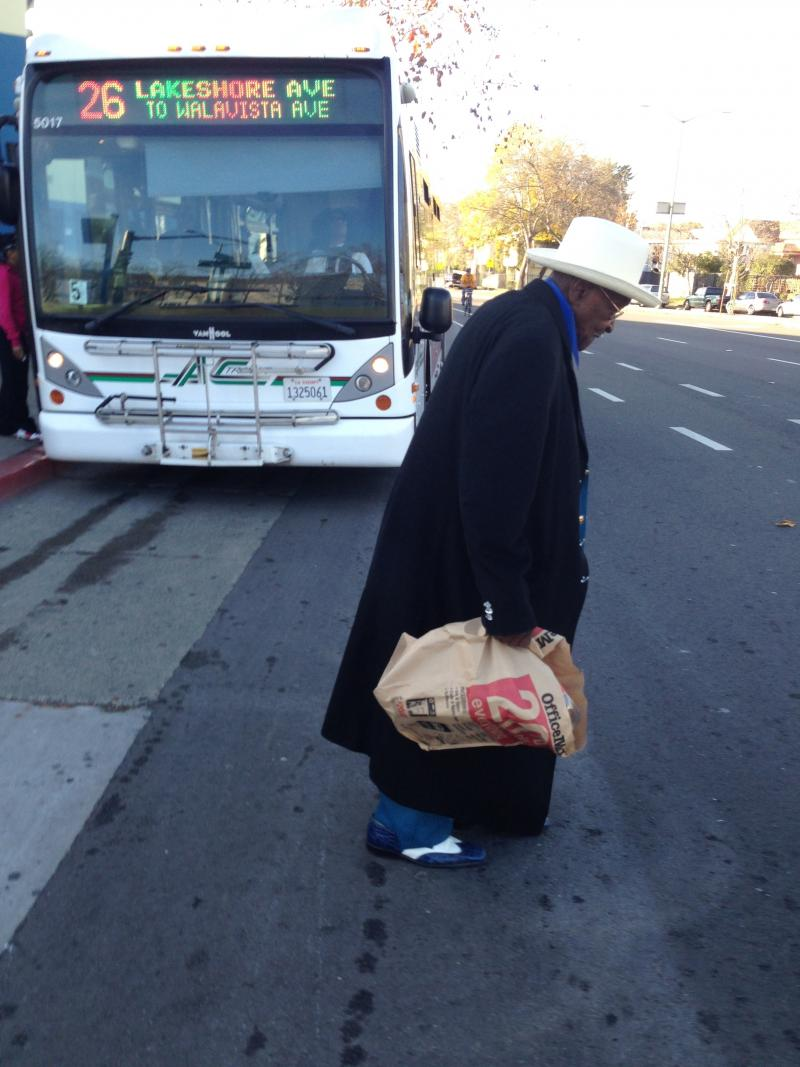 Long-time AC Transit rider Walter Davis gets off the bus at 14th and Market in Oakland.