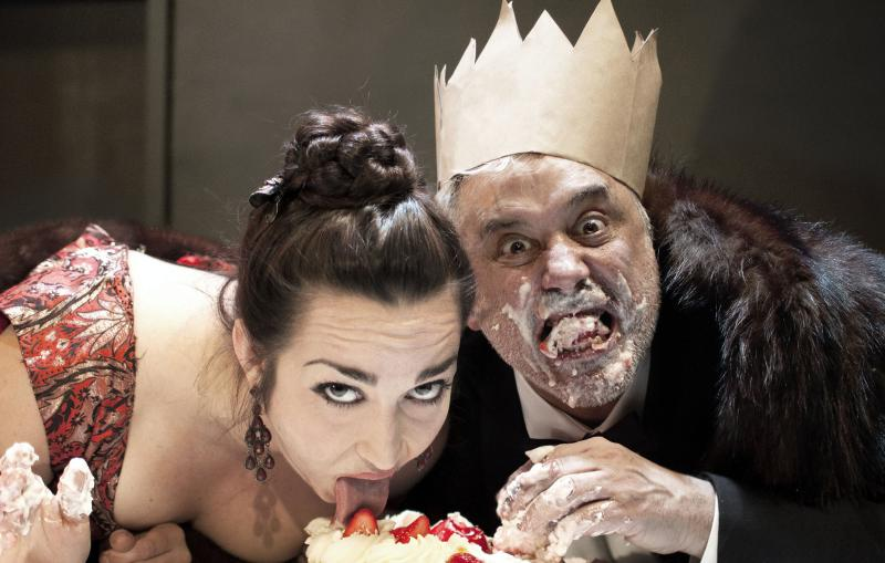 The gluttonous Mother (Ponder Goddard) and Father Ubu (David Sinaiko) over-indulge in Cutting Ball Theater's production of Alfred Jarry's avant garde classic, Ubu Roi.