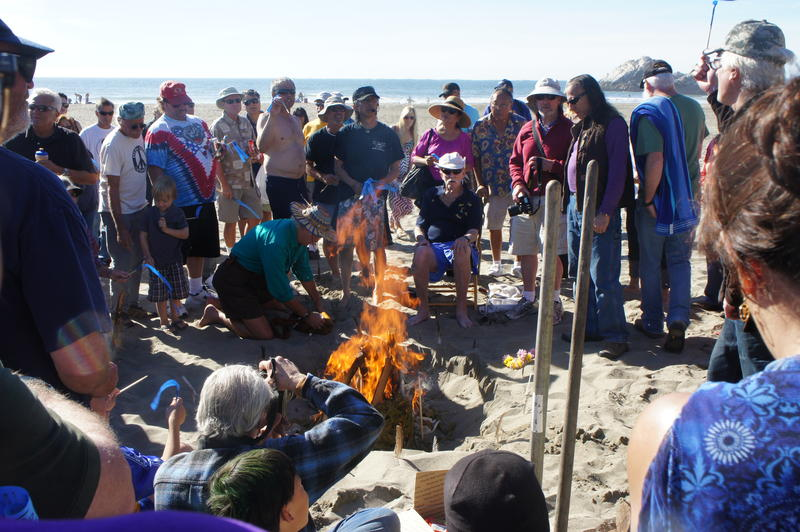 Names of surfers who have passed away are tossed into a fire at Kelly's Cove
