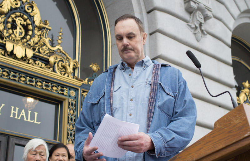 Jeremy Mykaels stands outside San Francisco's City Hall after speaking out against Ellis evictions.