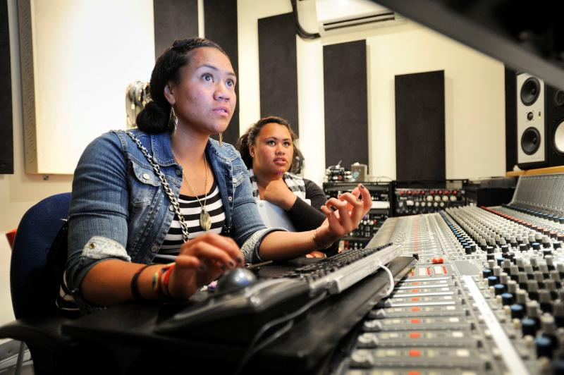Students from Girls on the Mic at Womens Audio Mission work on a project using the 40-channel mixing console once used by Soundgarden