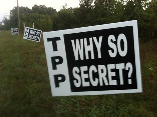 Yard signs placed in front of hotels in Leesburg, VA during TPP negotiations in September 2012