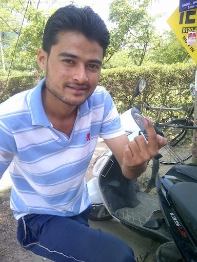 A man shows that he voted in India