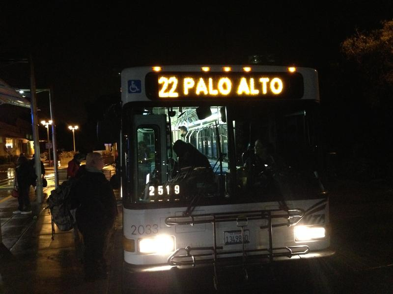 Elizabeth Garber talks to the bus driver at the Palo Alto Transit Center
