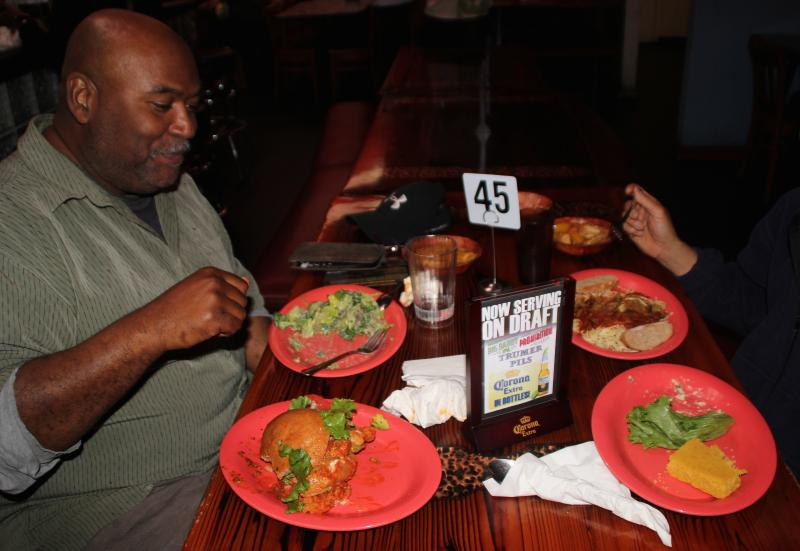 Sean Williams enjoys a meal at Souley Vegan restaurant in Oakland.