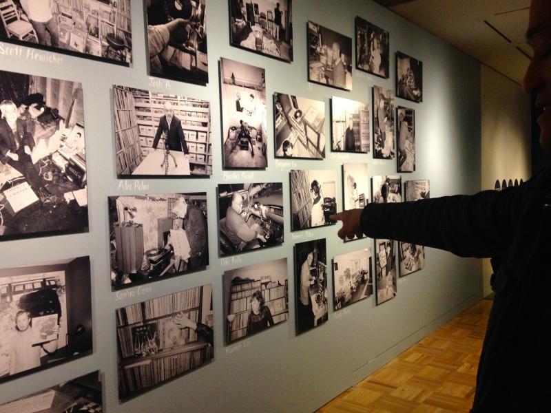 Senior Art Curator Rene De Guzman points out portraits of collectors