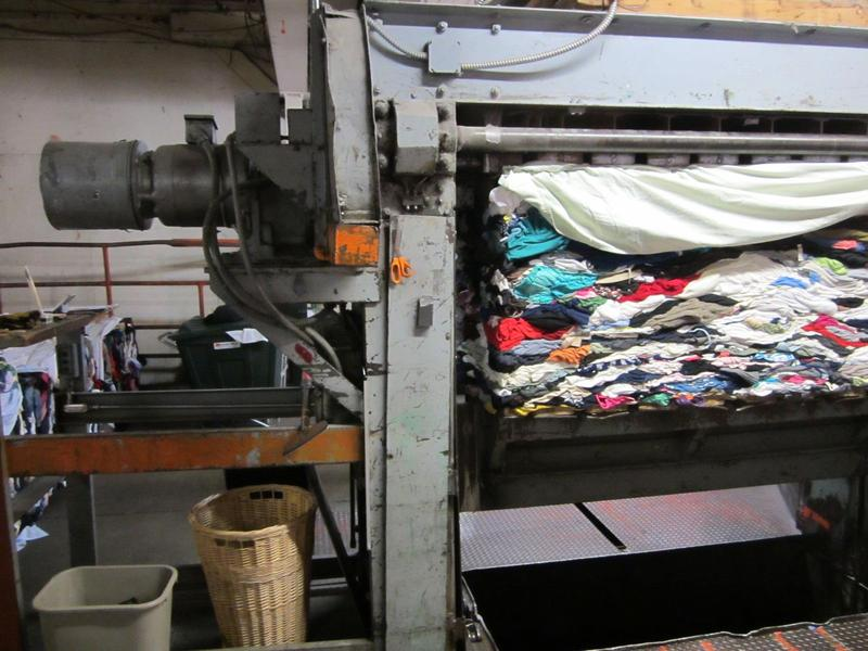 Clothes being squashed by the baler