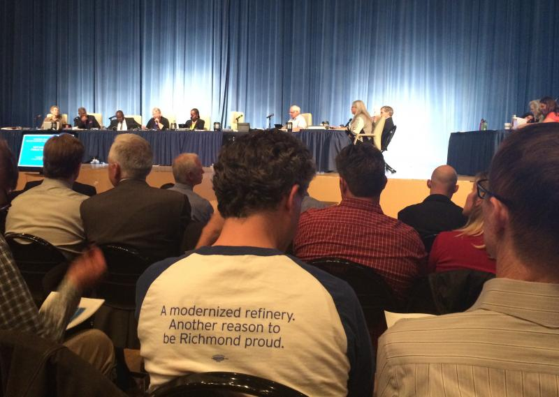 A Chevron worker shows his support for a $1 billion refinery upgrade on the back of his shirt during last week's Richmond City Council meeting